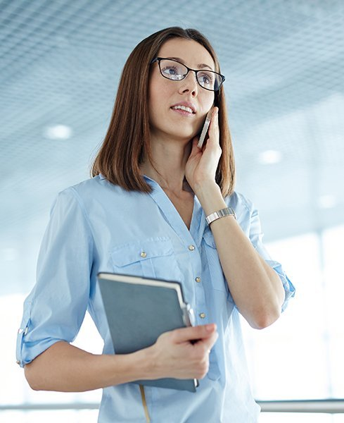 Businesswoman talking on the phone at office