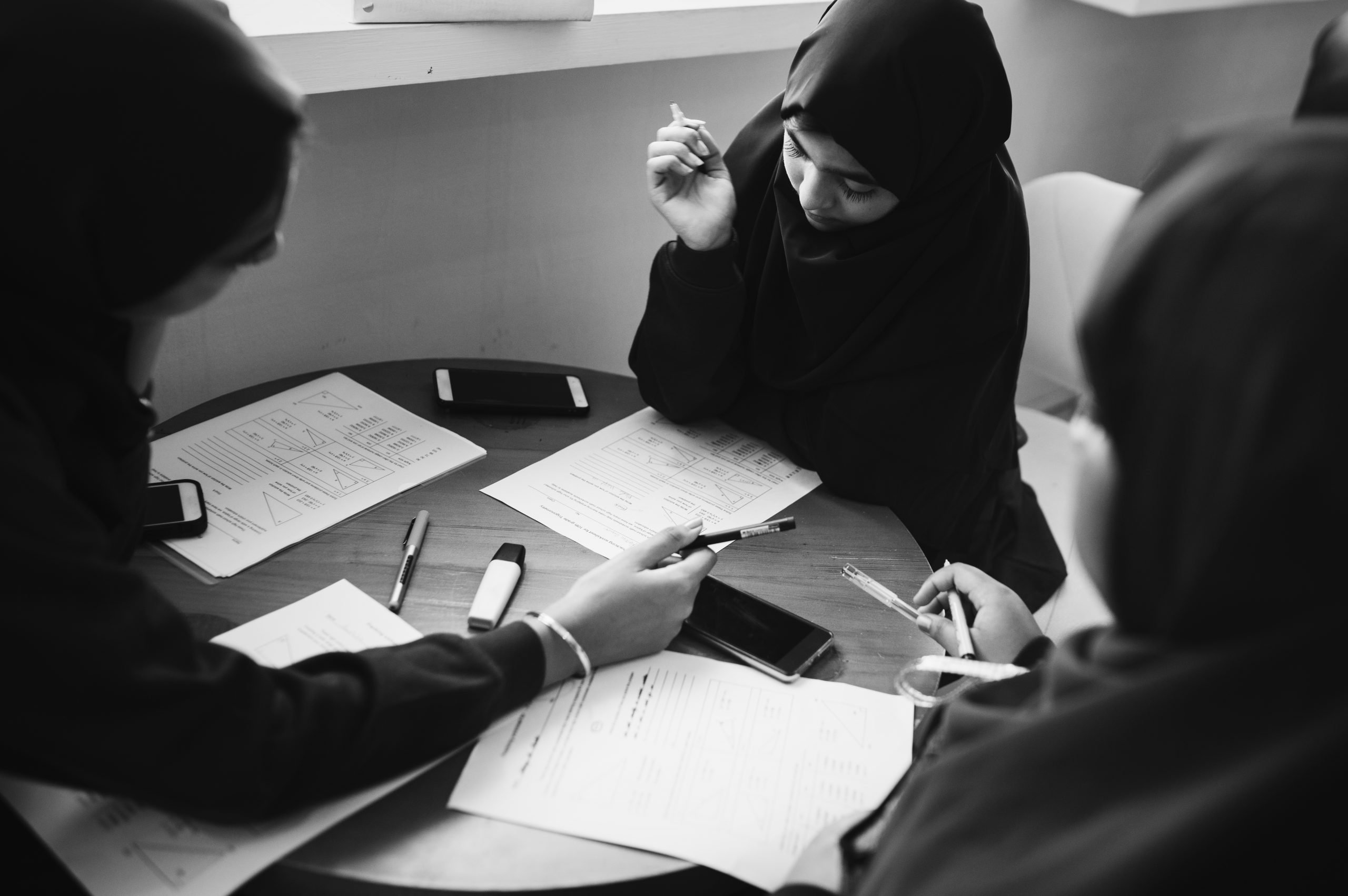 Diverse muslim girls studying in a classroom